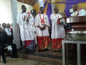 Founding Members Udo Sam Umoatan, Amah T. Amah and Ikpong Essien-Udom doing special thanksgiving to God for keeping them and the other eight members alive and well in the past 27 years