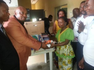 President Presenting Books, Computers and EVD Screening Equipment for Nursery/Primary Schools